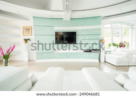 Plasma TV on the wall in elegant luxury interior - stock photo