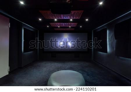 Plasma TV on the wall in modern interior - stock photo