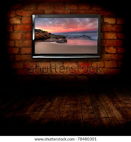 Plasma TVs on the wall - stock photo
