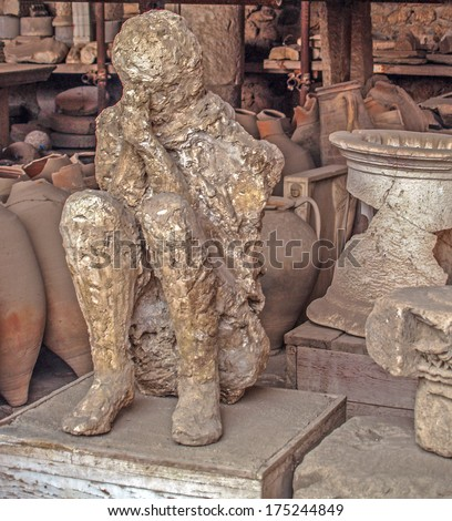 Plaster cast of a Pompeii chariot driver who died during the eruption of Mt. Vesuvius (near Naples, Italy) in AD 79 - stock photo