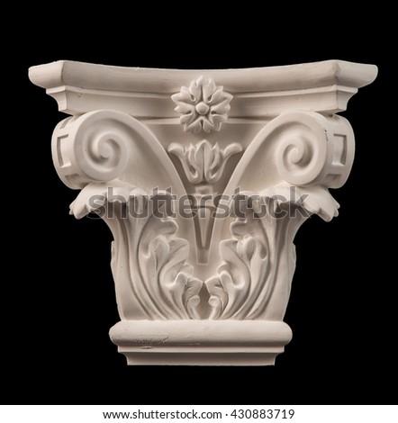 plaster column Capitelli on a black background - stock photo
