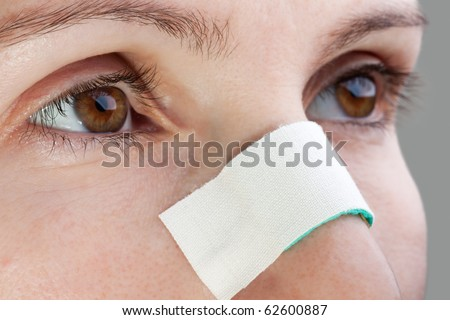 Plaster on human blood injury wound nosebleed nose - stock photo