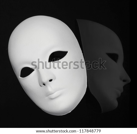 Plaster Venetian mask on black - stock photo