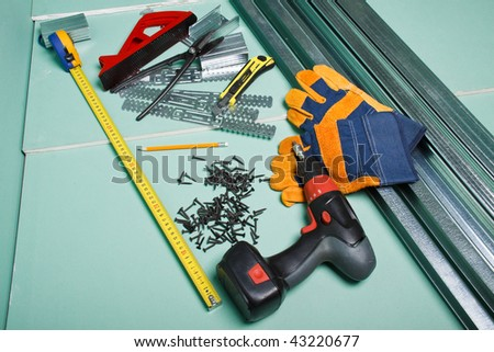 Plasterboard and various building tools.  Apartment repair. - stock photo