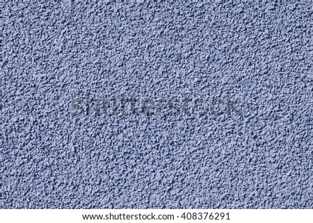 Plastered colored surface with tiny stones