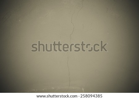 Plastered wall with a vertical crack. Background. Toned gray. - stock photo