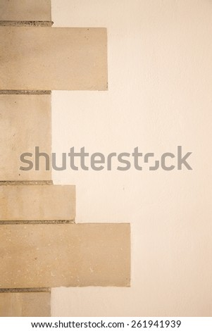 plastered wall with tiles along one edge.
