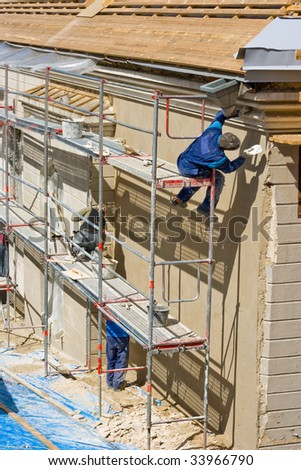 Plasterers at work on a scaffold