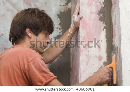 plastering - man makes renovation indoor