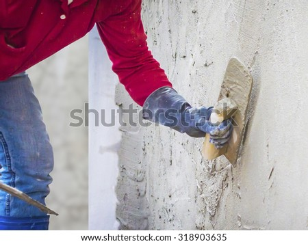 plastering mortar on the wall - stock photo