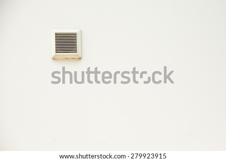 plastic air vent in white wall ventilation grille