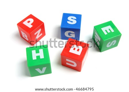 Plastic Alphabet Cubes on White Background
