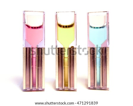 Plastic and alloy test tube filled with colorful chemical solutions. These cuvettes are used in the laboratory for various samples: genetic DNA modification or spectrophotometry. Ideal for innovation.