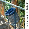 plastic bag and basket for dust in park of barcelona - stock photo