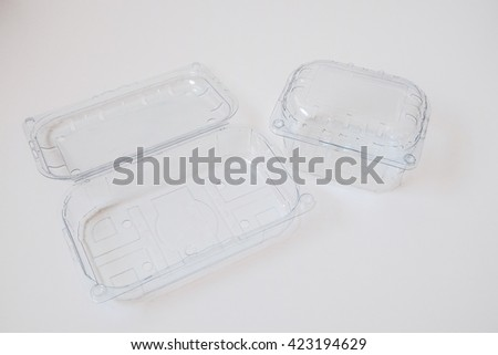 Plastic bag and plastic box using daily on white background - stock photo