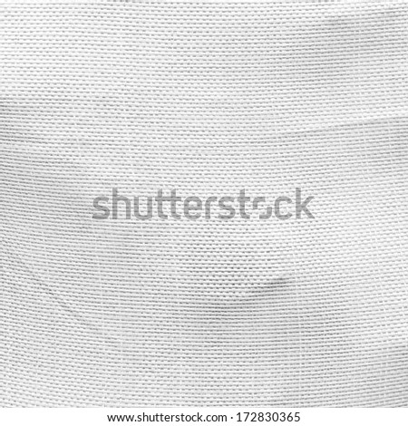 plastic bag full of dry peat briquettes background, woven texture - stock photo