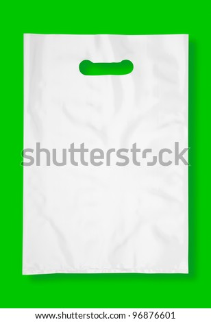 Plastic bag on green with shadow (with clipping path) - stock photo