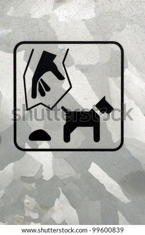 Plastic bag sign for dog poo on - stock photo