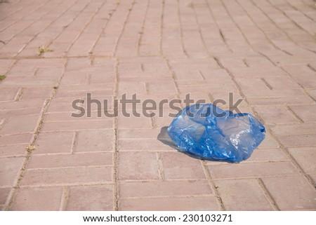 Plastic bag thrown on the street - stock photo