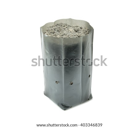 plastic bag with a soil on white background - stock photo