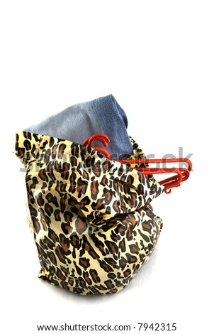 plastic bag with panther print for sale with clothes - stock photo