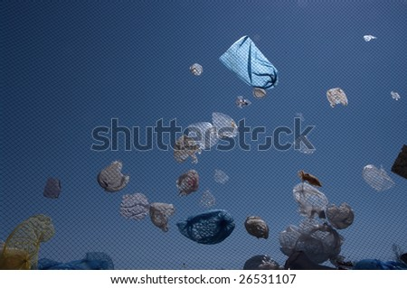 Plastic bags flew from a landfill - stock photo