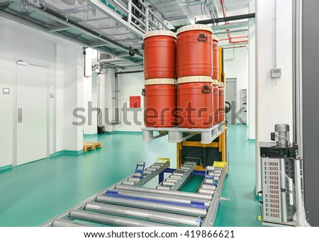 Plastic Barrels at Automated Storage and Retrieval System in Warehouse - stock photo