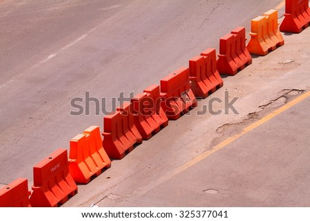 Plastic barriers blocking the road isolated on background with clipping path