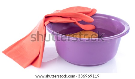 Plastic basin with gloves and sponge, isolated on white - stock photo
