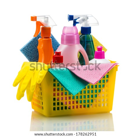 Plastic basket with cleaning supplies, isolated on white background - stock photo