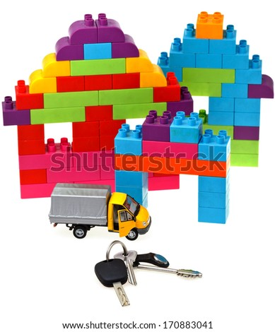 plastic block house, door and car keys, model truck on white background - stock photo