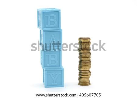 Plastic blocks next to a pile of money  - stock photo