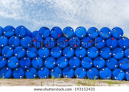 Plastic blue chemical barrels stacked up.  - stock photo