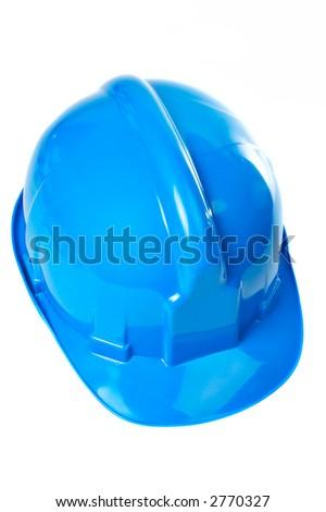 Plastic blue hard hat on white background - stock photo