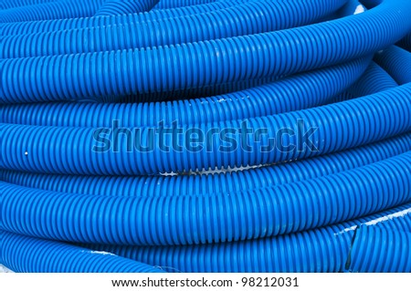 Plastic blue pipes background - stock photo