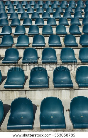 plastic blue seats on stadium