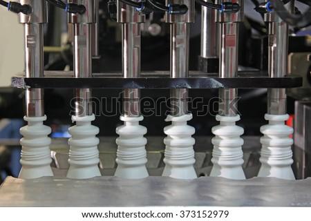 Plastic Bottle Blow Molding Machine in factory - stock photo