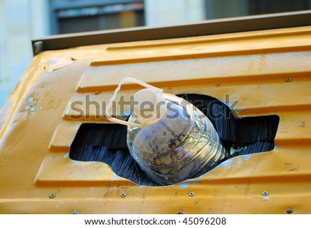 plastic bottle in  container for a waste and  processing - stock photo