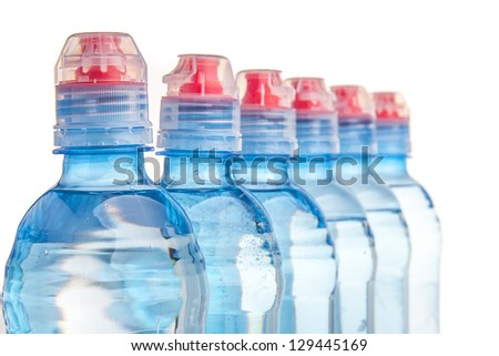 Plastic bottle of drinking water isolated on white - stock photo