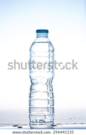 Plastic bottle of drinking water isolated on white background - stock photo