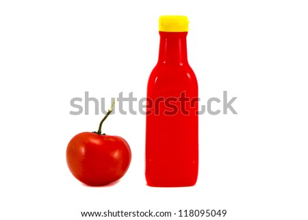 plastic bottle of ketchup and tomato on white background