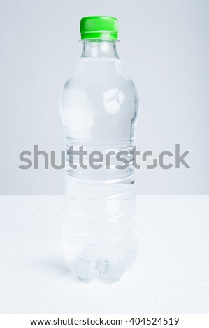 Plastic bottle of purified drinking water as hydration and refreshment concept isolated on white background - stock photo