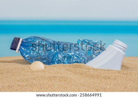 Plastic bottle on the beach - stock photo