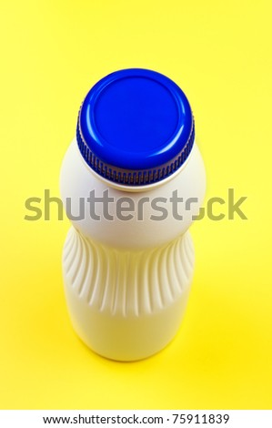 Plastic bottle on yellow background top view. - stock photo