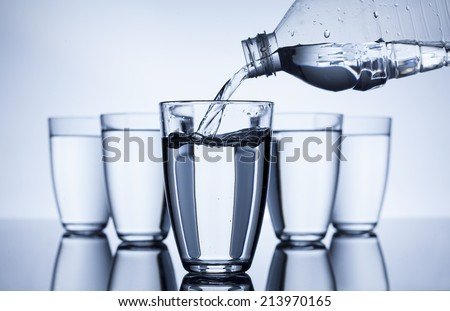 plastic bottle that fill up with water group of glasses on white background - stock photo