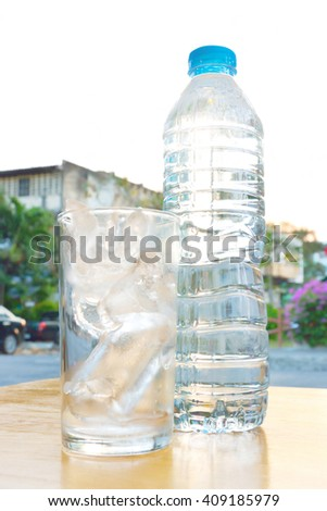 plastic bottle with ice glass - stock photo