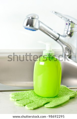 plastic bottle with liquid soap in bathroom