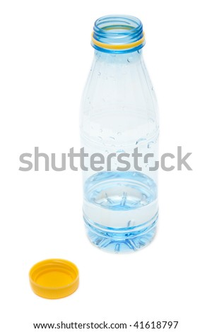 Plastic bottle with water and open yellow lid on white background - stock photo