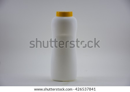 Plastic bottle with yellow lid for Baby powder product isolated.On white background.  - stock photo