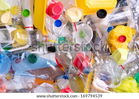 Plastic bottles and containers prepared for recycling - stock photo